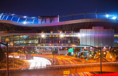Denver Broncos Mile High Stadium from the outside at night