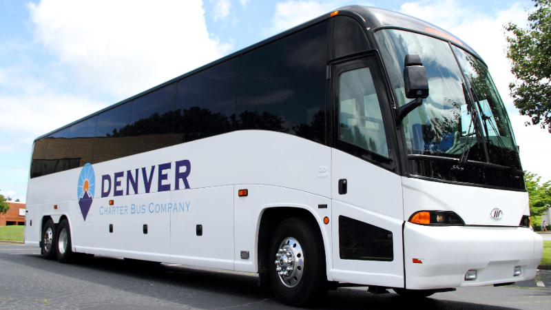 a charter bus with a Denver Charter Bus Company logo on the side