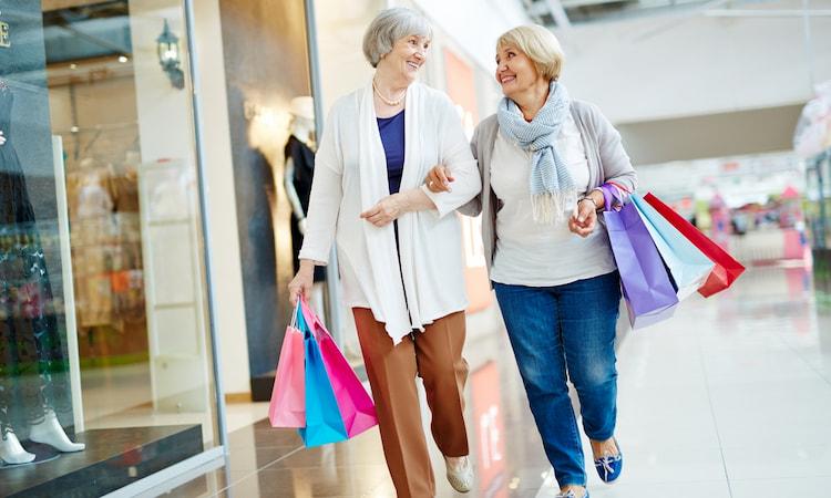 a senior couple walks through a mall in Denver