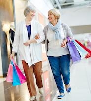 two seniors walk in a Denver shopping mall